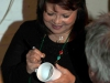 Francoise signing mugs designed by Paul Muscat