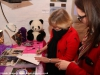 Julie signing autographs